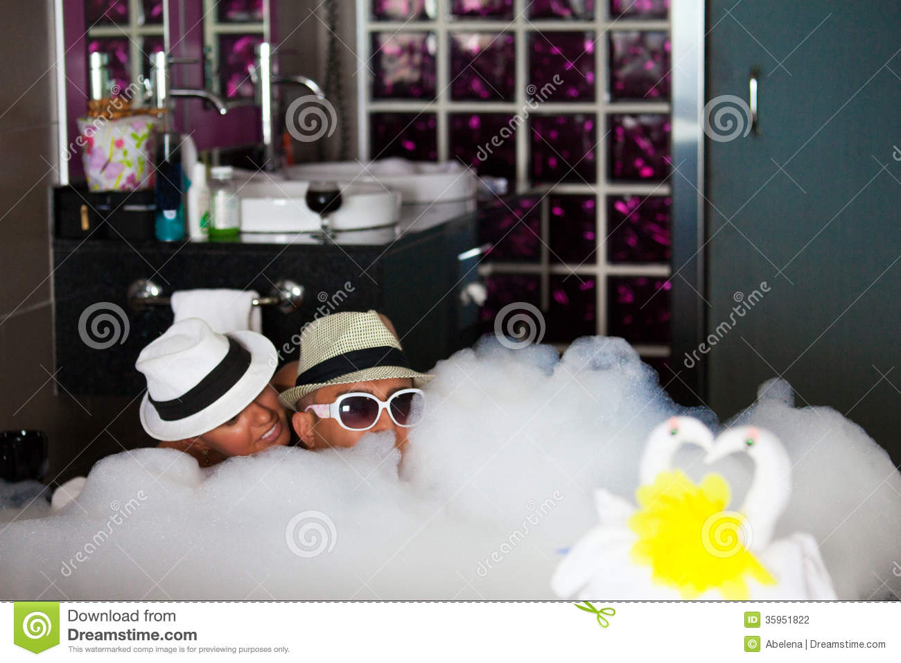 Loving Couple Lie In A Bathroom With Bath Foam Stock