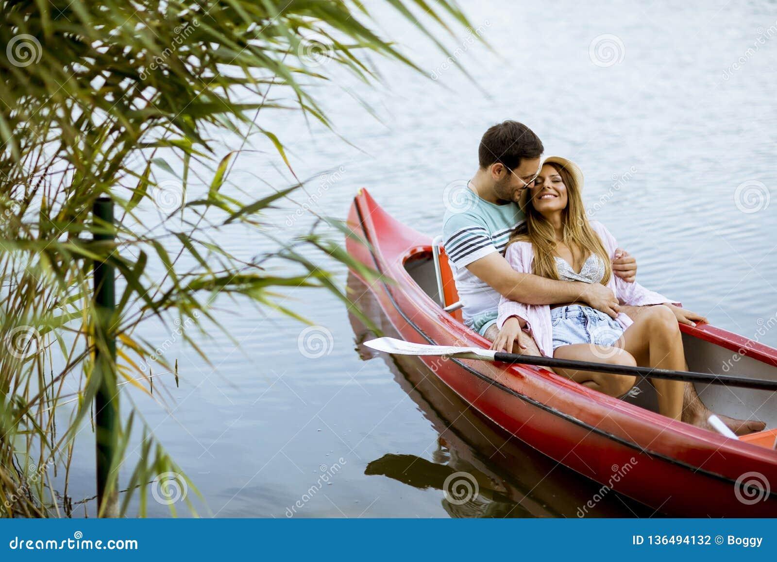 Loving Couple Rowing On The Lake Stock Photo - Image of ...