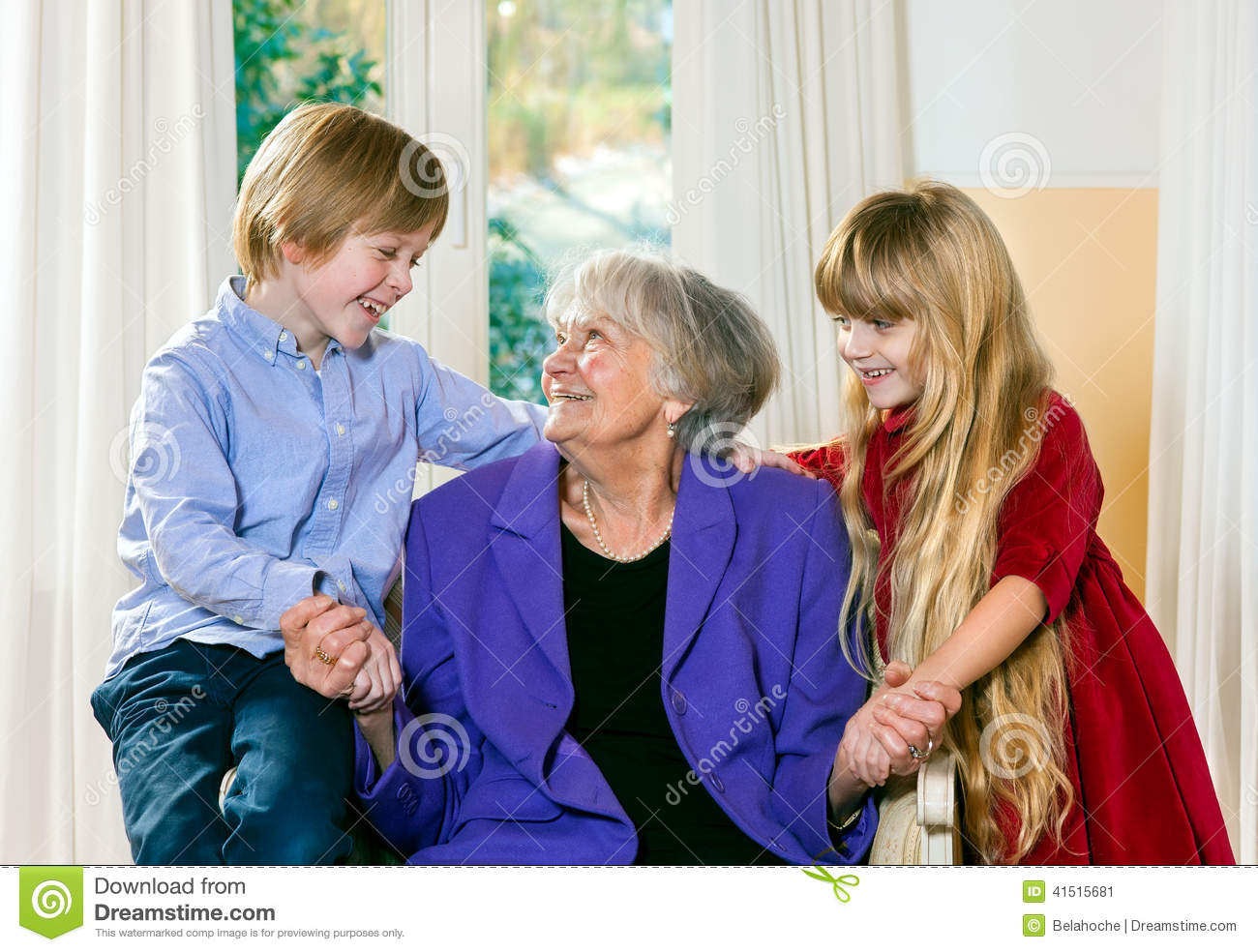 Loving Little Boy And Girl With Their Grandmother Stock