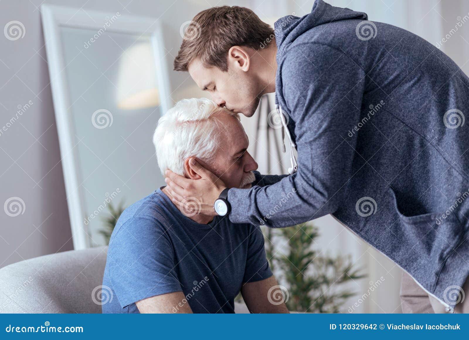 Loving man endorsing senior man