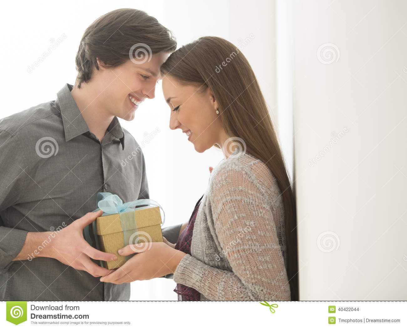 Loving Man Giving Birthday Gift To Woman