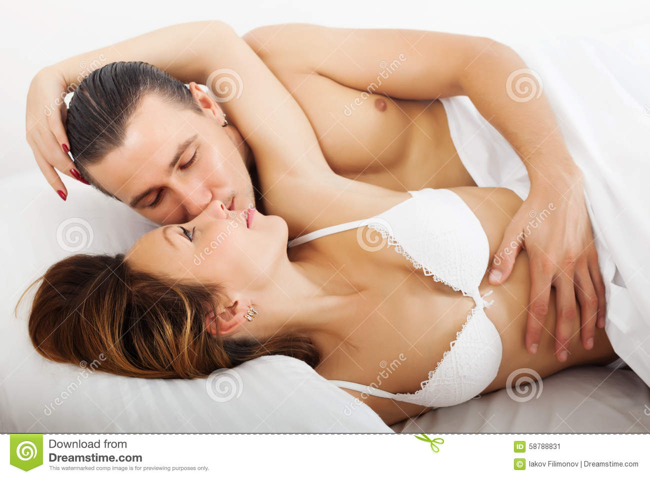Men and women in bed together