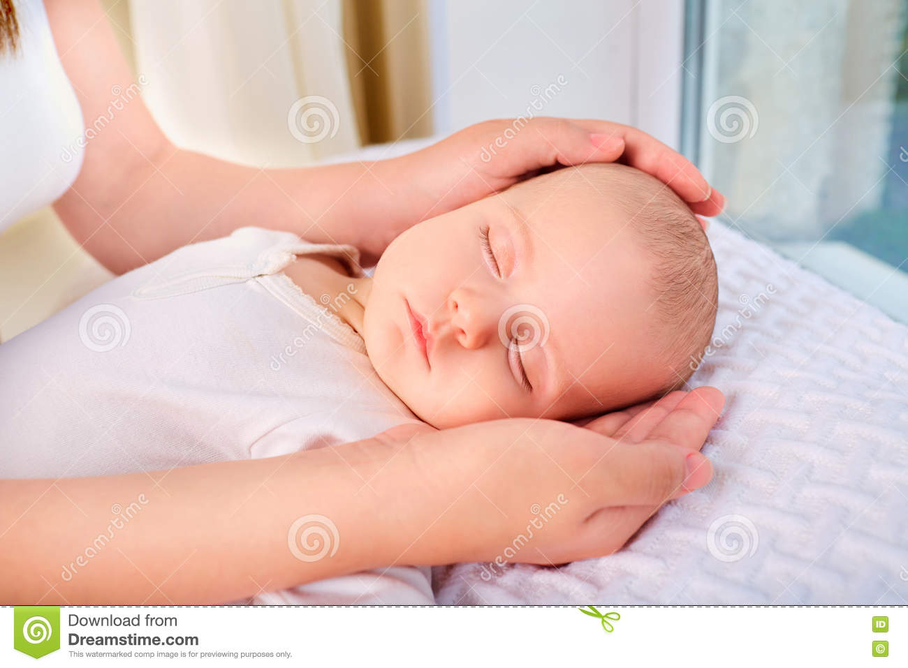 320cd55a24d Loving mom hand holding cute sleeping newborn baby child. Mother holding  head of her child in hands. The baby on hands at mum. Baby sleeping.