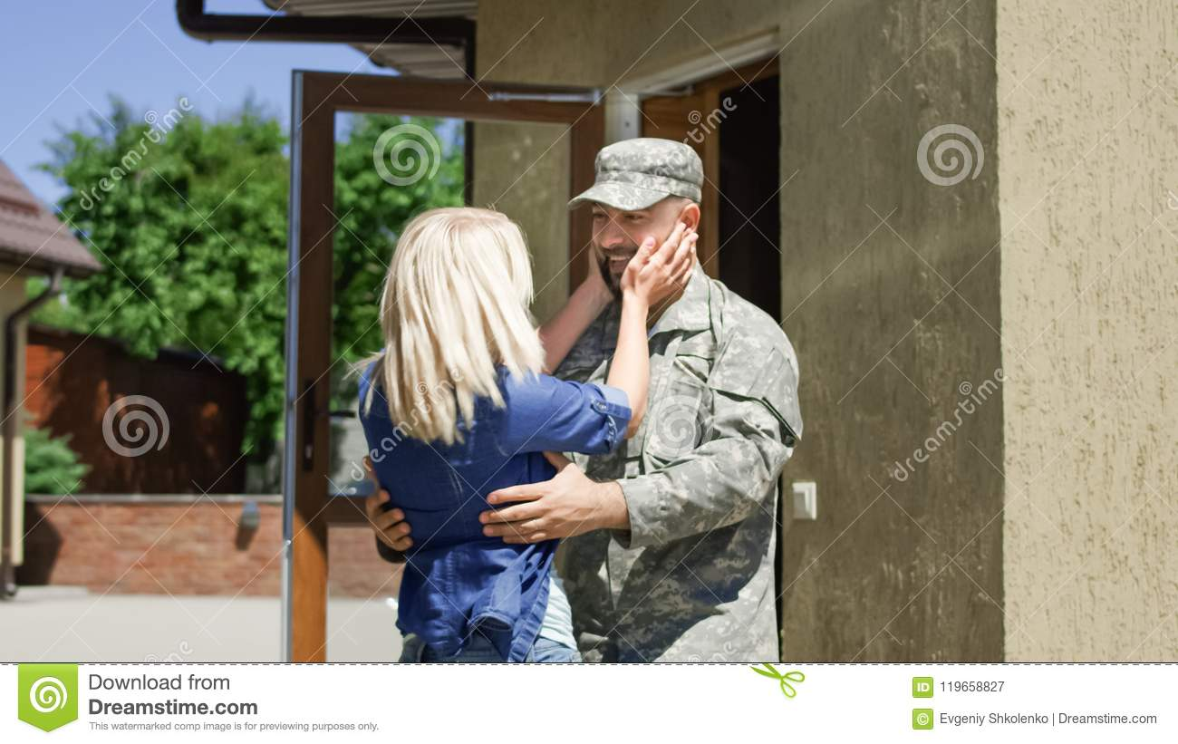 Loving wife meeting soldier at home