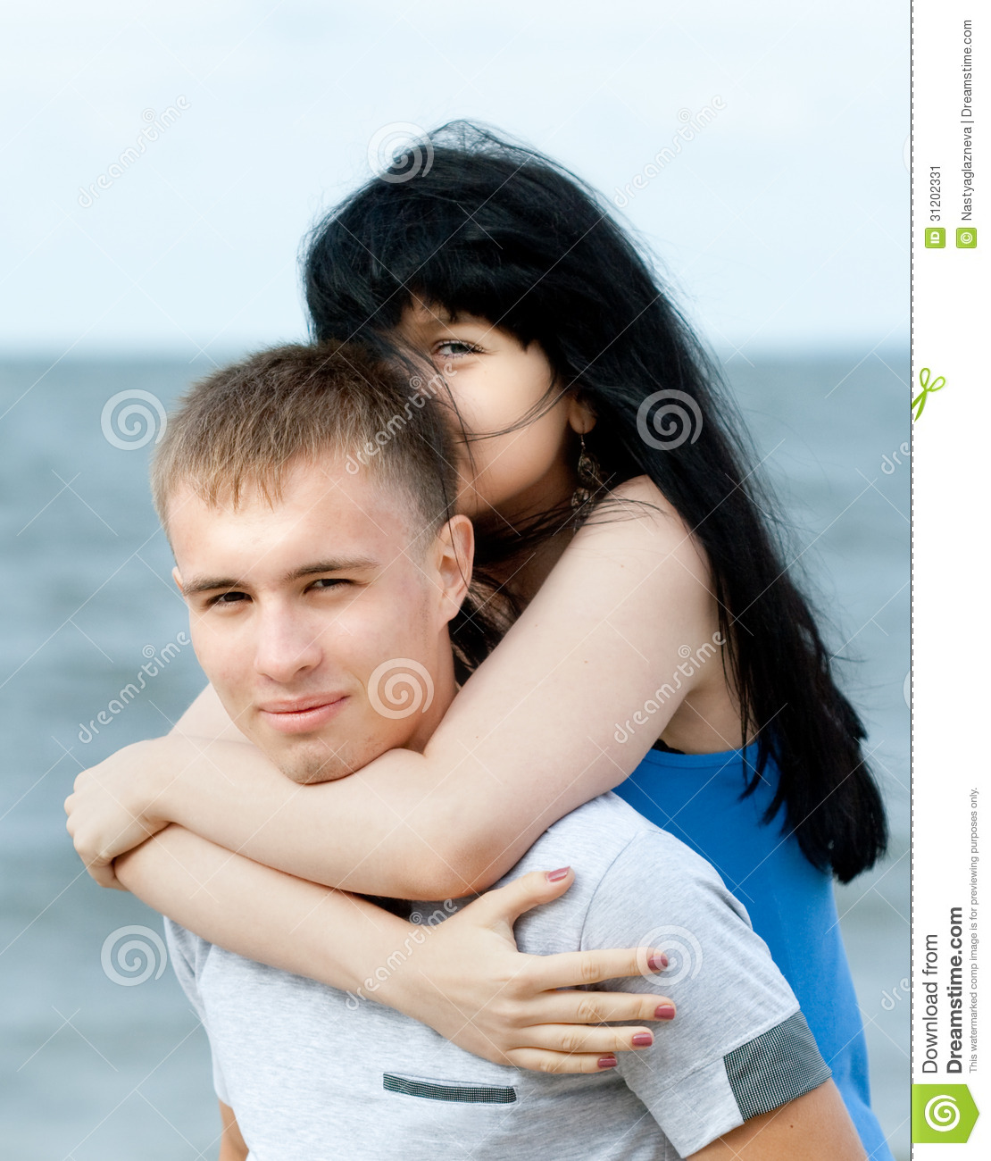 Loving Young Couple At Sea Stock Image. Image Of Arms
