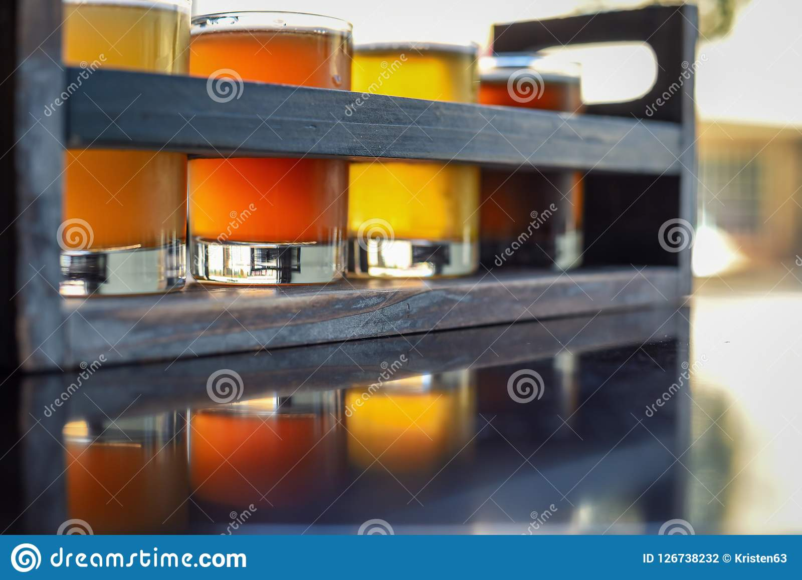 Low angle closeup of beer flight with space for copy