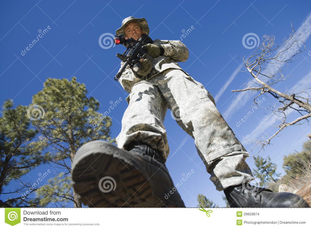 Low Angle Portrait Of Armed Soldier Stock Images - Image: 29659874