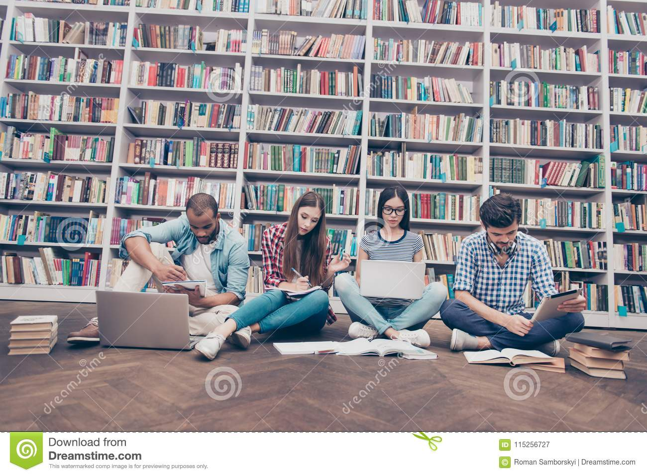 Low angle shot of four international clever bookworms students i