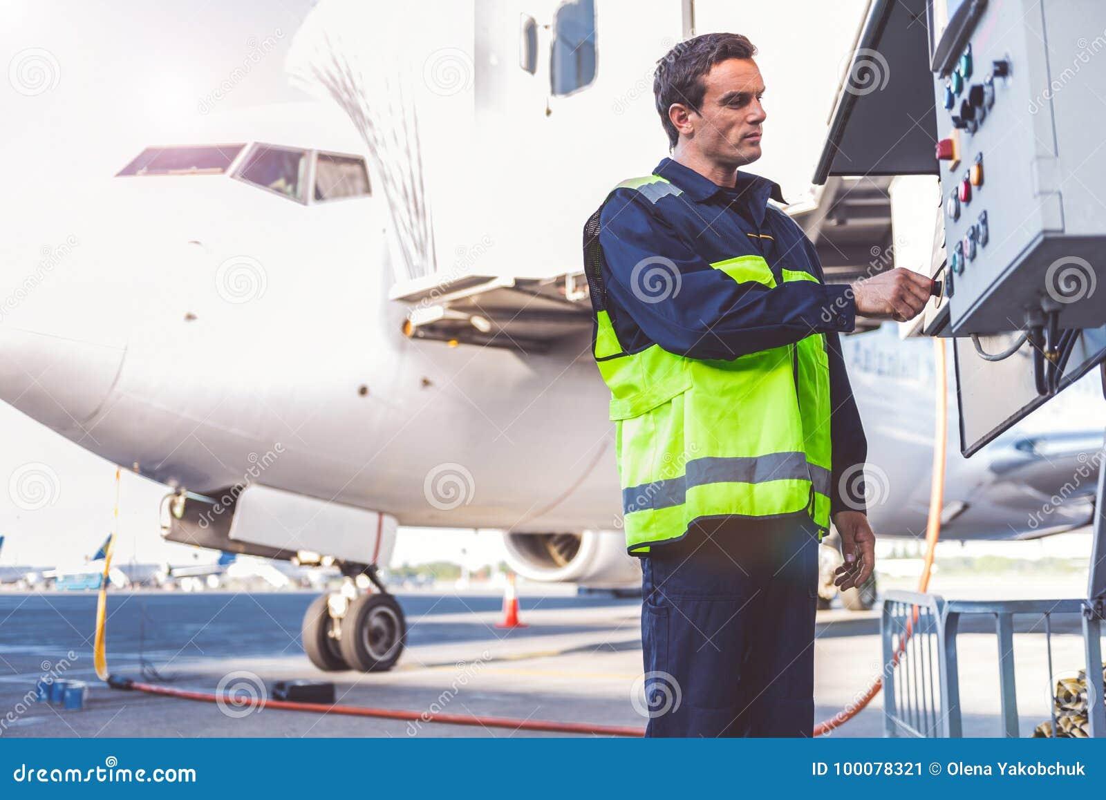 Serene male worker checking equipment