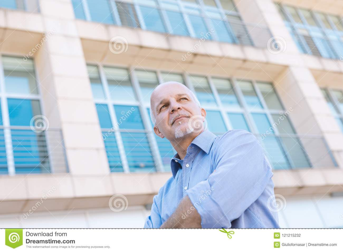 Low angle view of senior man looking off