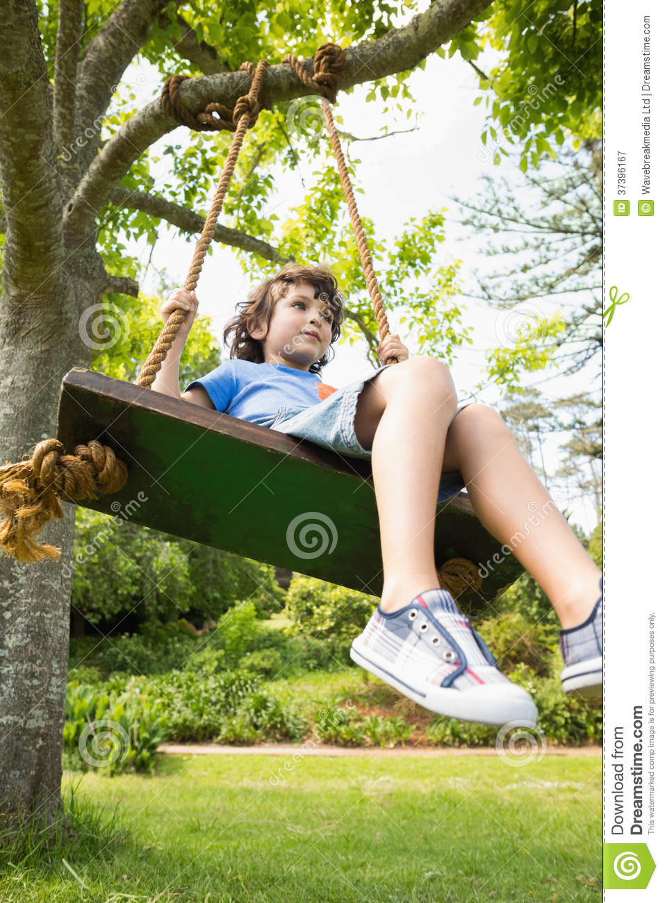 Low Angle View Of A Cute Little Boy On Swing Royalty Free