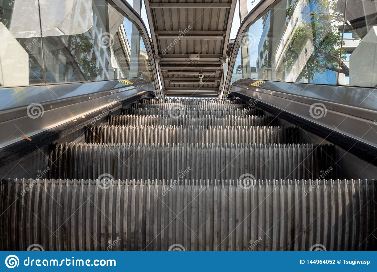Low angle view looking to top of modern escalator