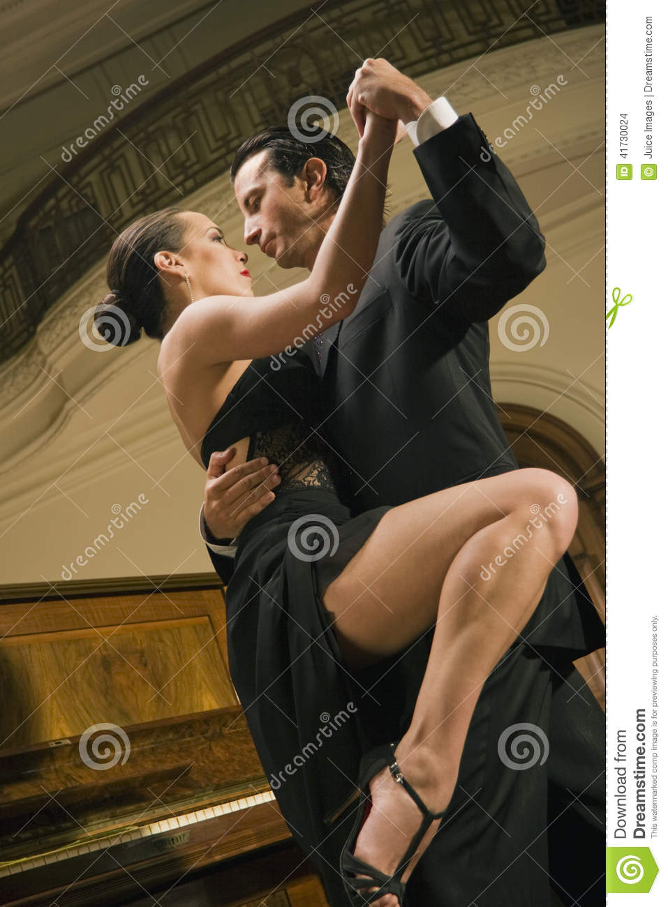 Low angle view of a young couple dancing