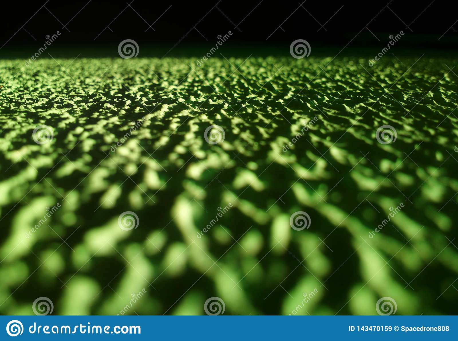 Low angled green concrete texture background hd