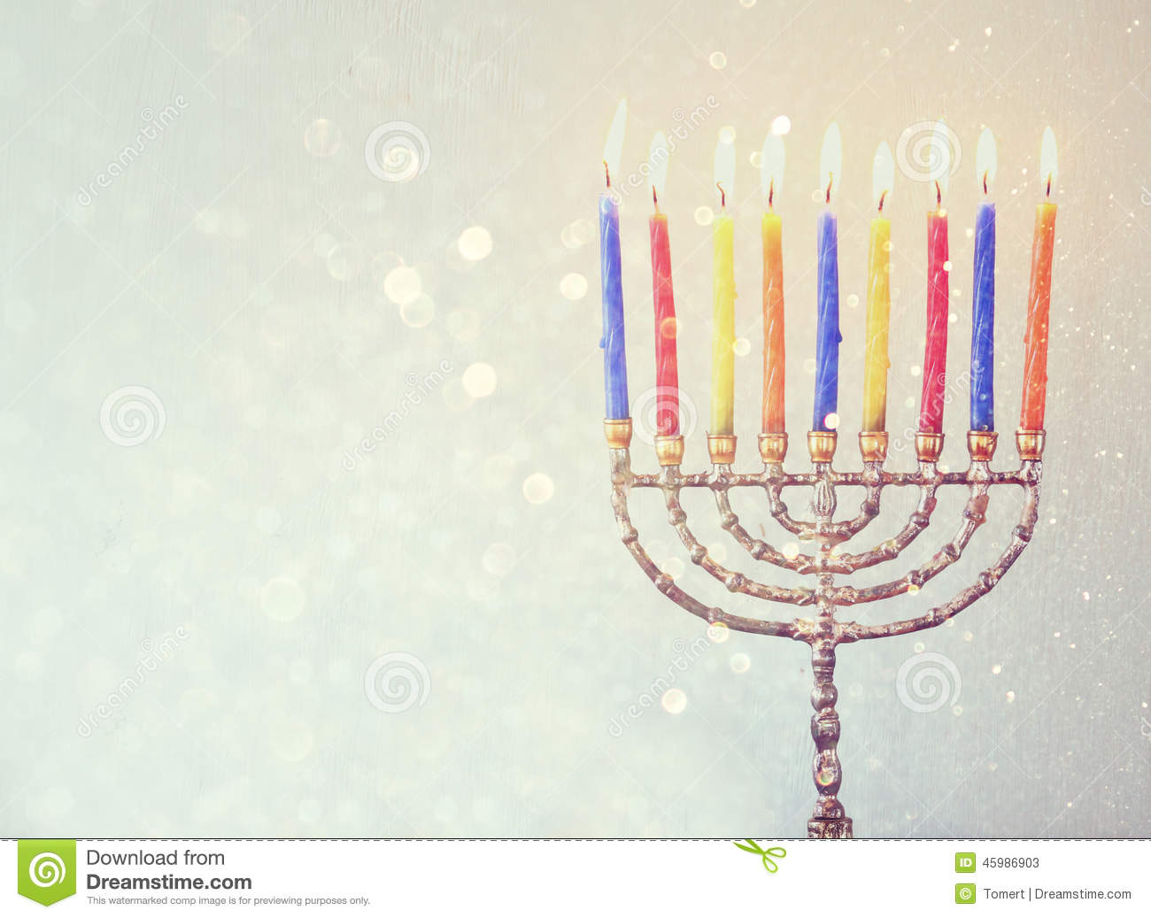 Low key image of jewish holiday Hanukkah background with menorah Burning candles over glitter background