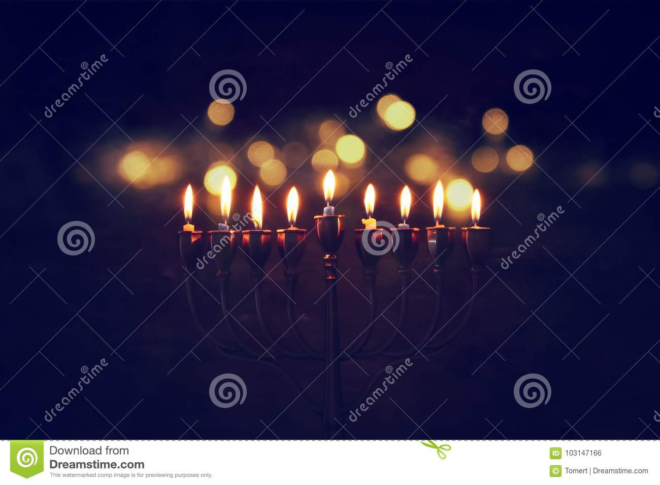 Low key image of jewish holiday Hanukkah background with menorah & x28;traditional candelabra& x29; and burning candles