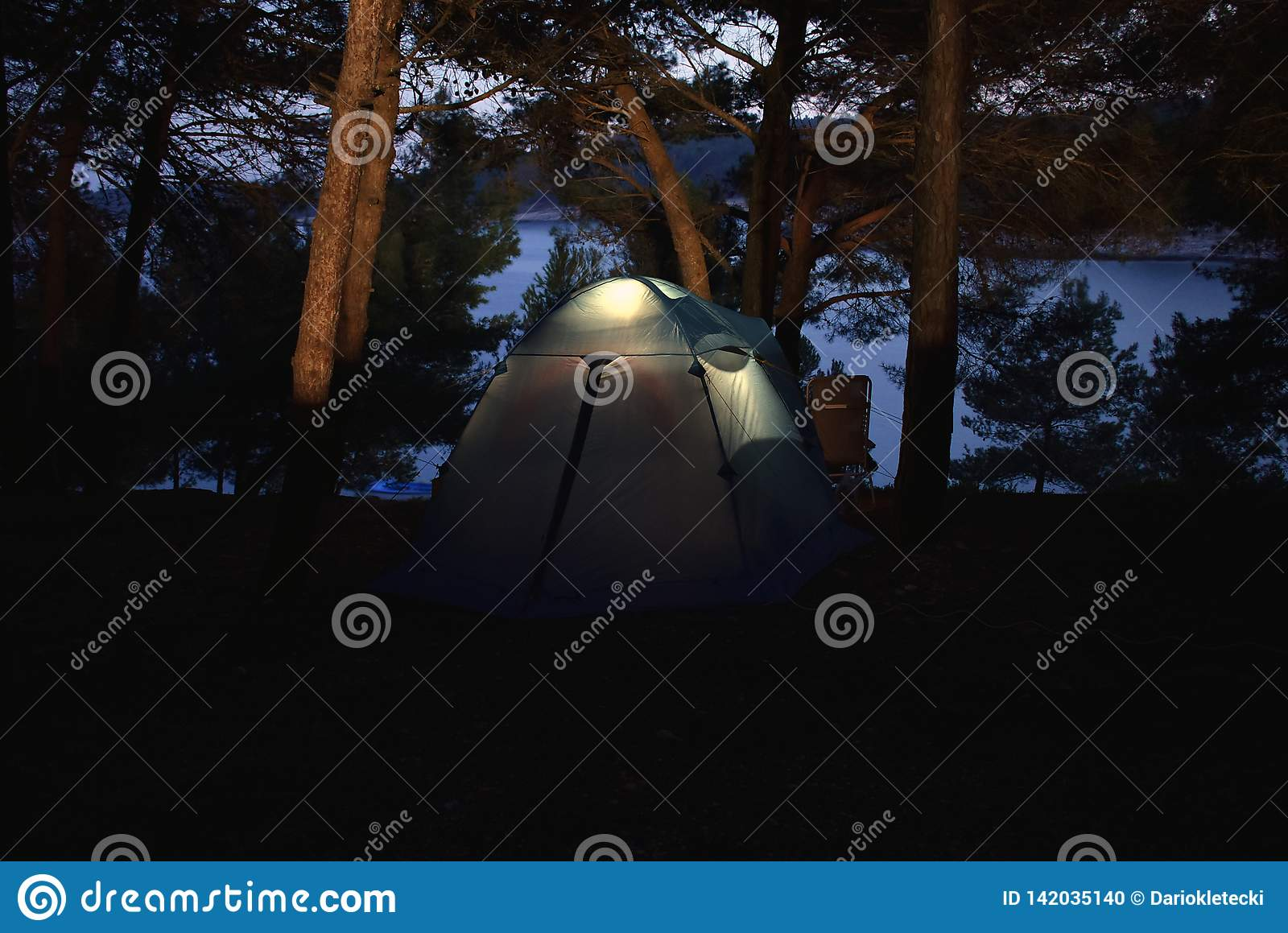 Low light photo of a tent in camp in Istria