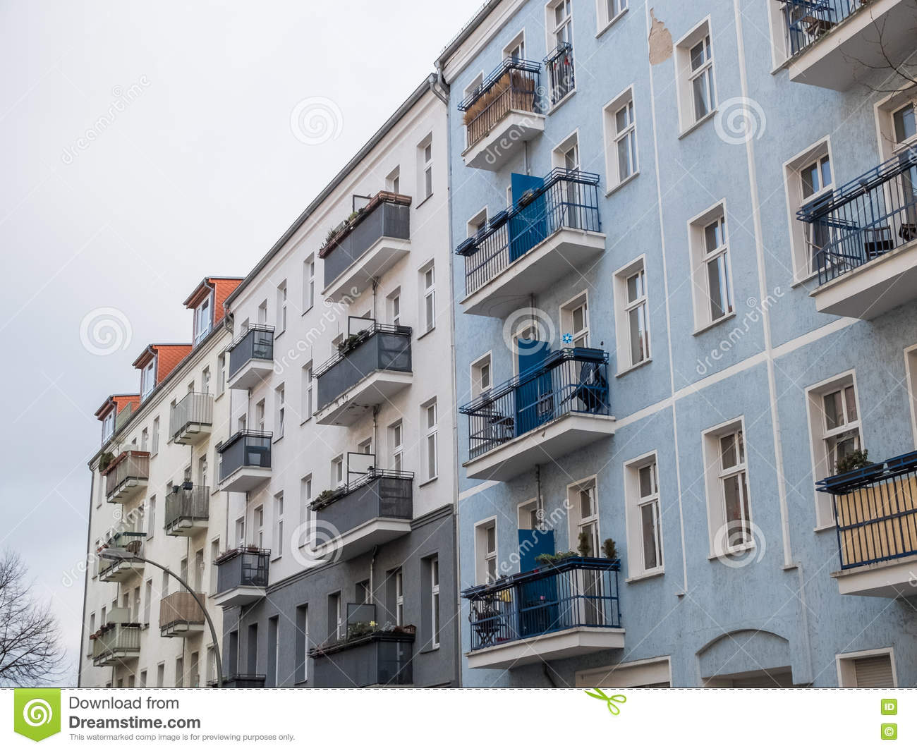 Apartment buildings with small balconies stock image for Building balcony