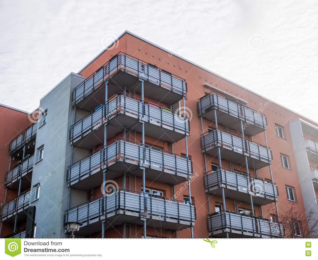 Low rise modern apartment building with balconies stock for Building balcony