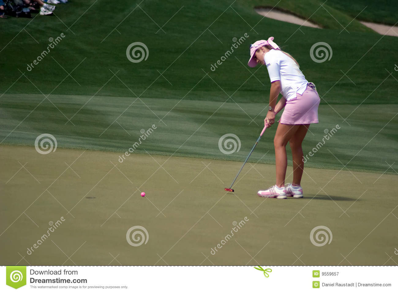 top less woman putting golf