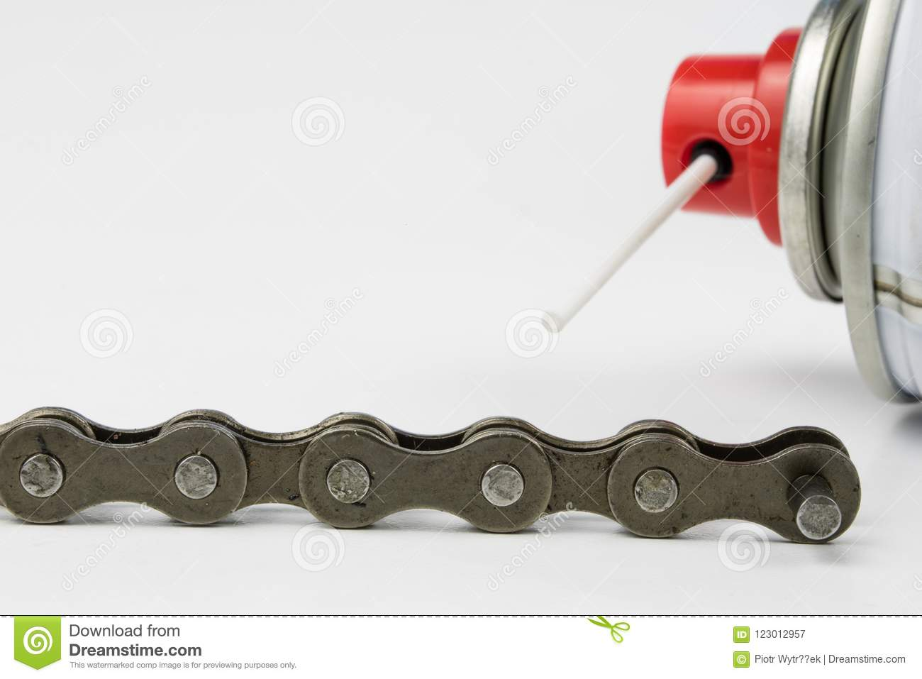 Lubricating the bicycle chain with liquid lubricant. Periodic se