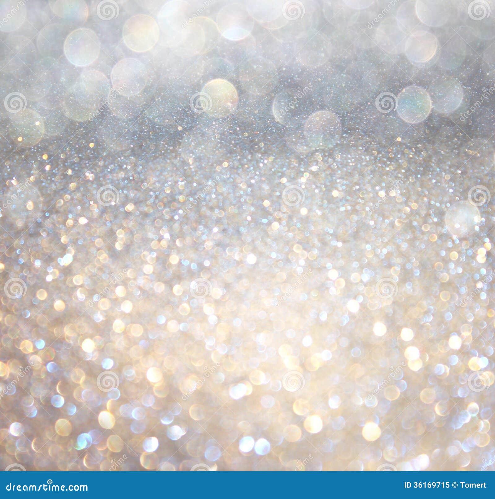 Luces abstractas blancas del bokeh de la plata y del oro. fondo defocused