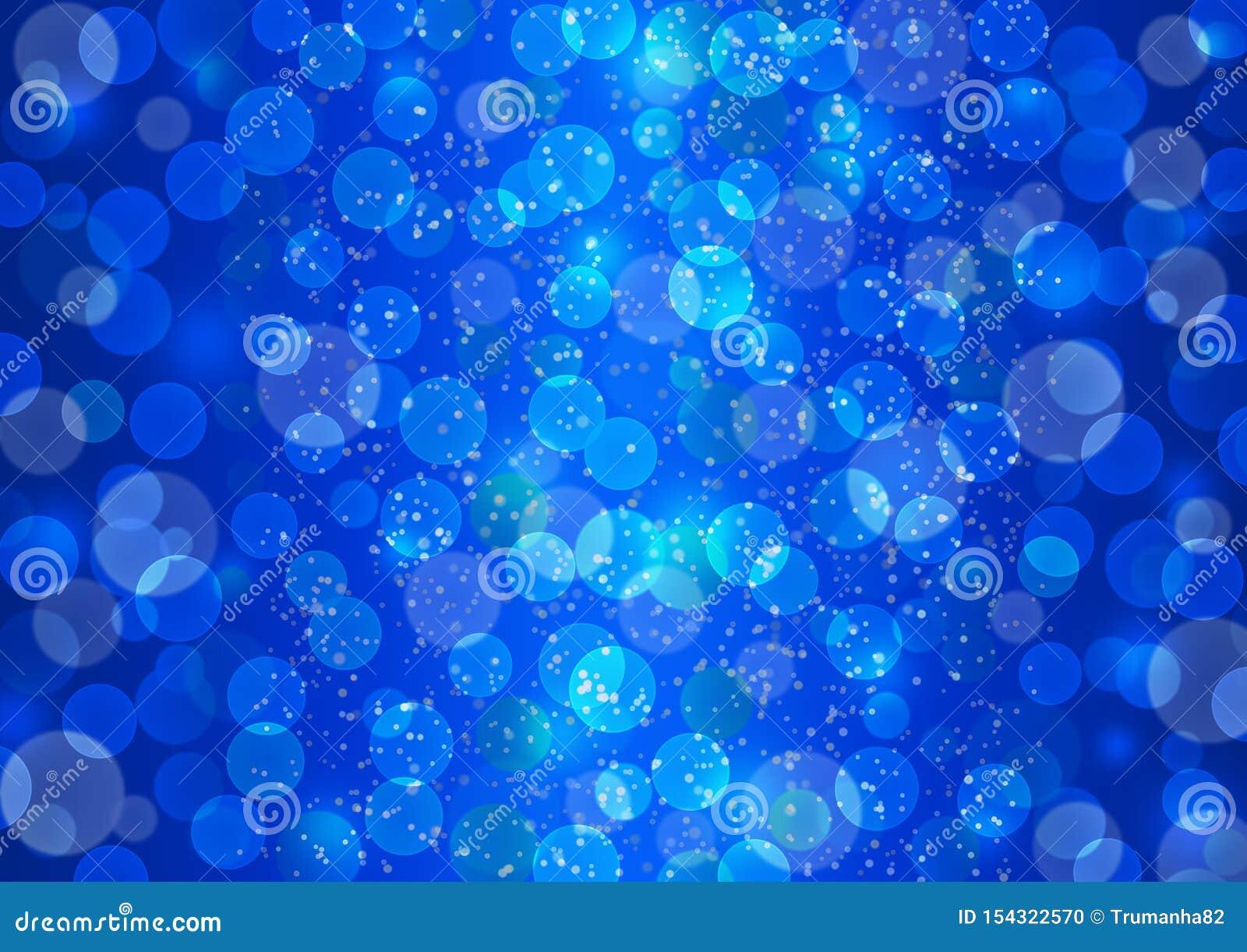 Luces brillantes de Bokeh y chispas que brillan en fondo azul