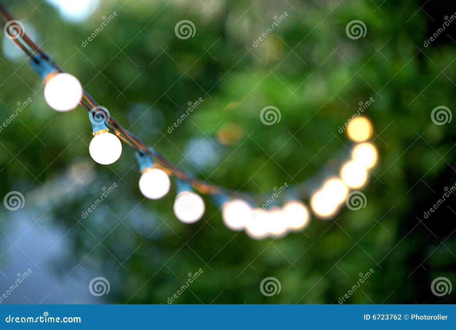Luces de la navidad decorativas colgantes foto de archivo for Luces decorativas jardin