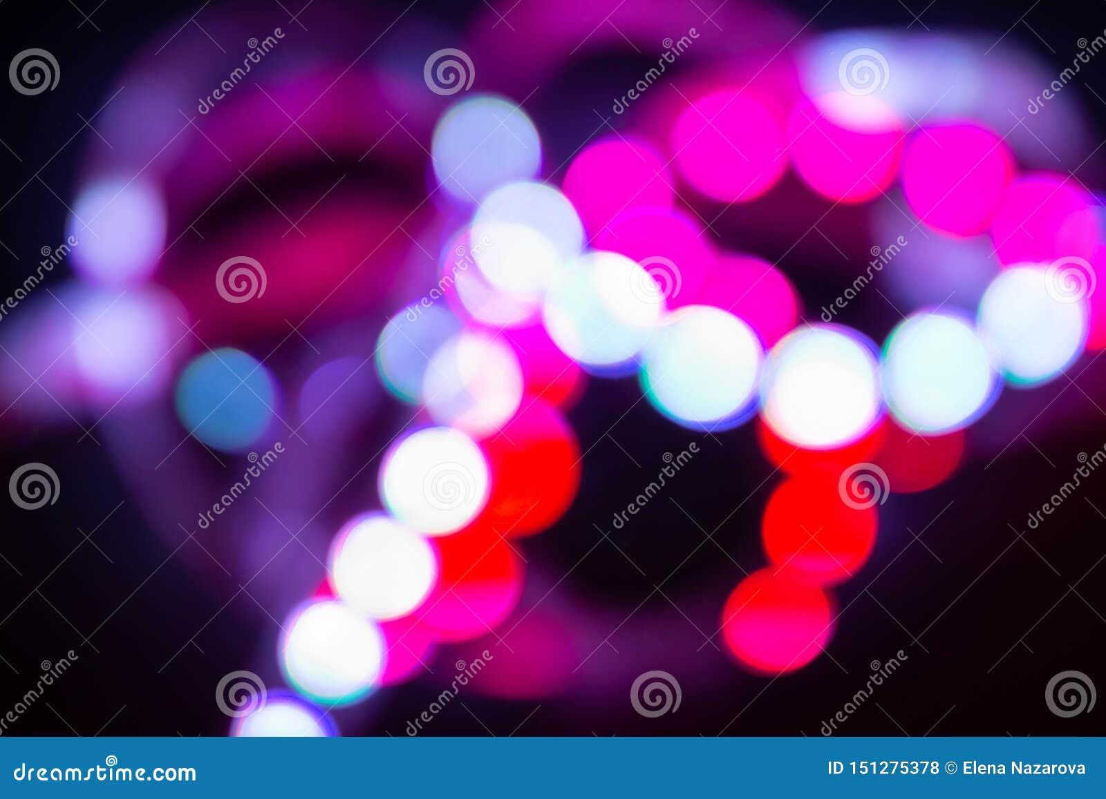 Luces de neón del bokeh en negro Fondo borroso extracto brillante