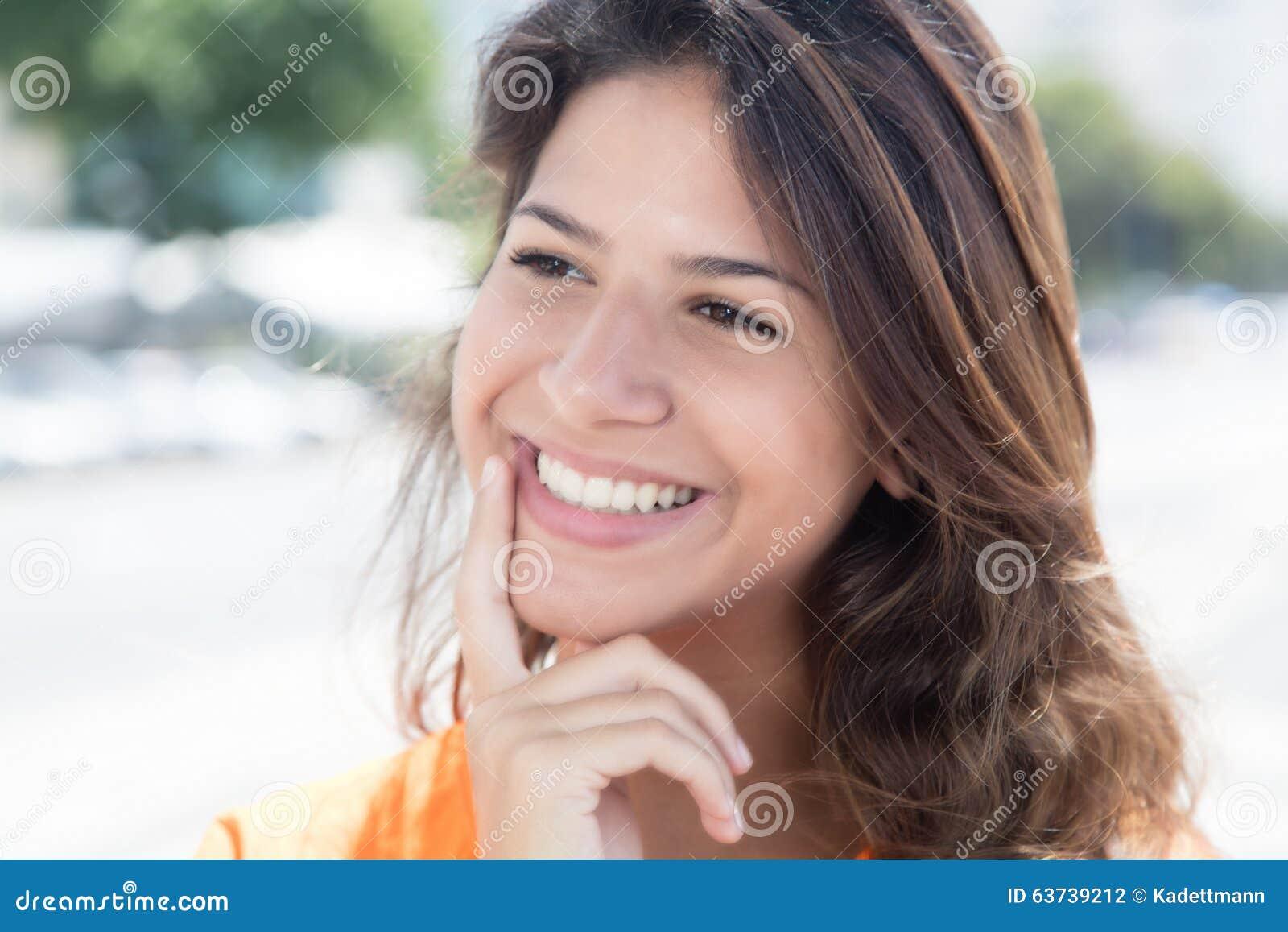 Lucky caucasian woman in a orange shirt