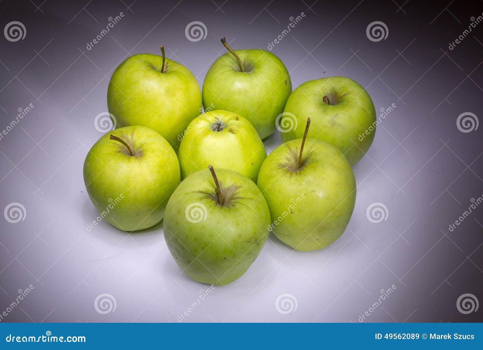 Lucky seven green apples