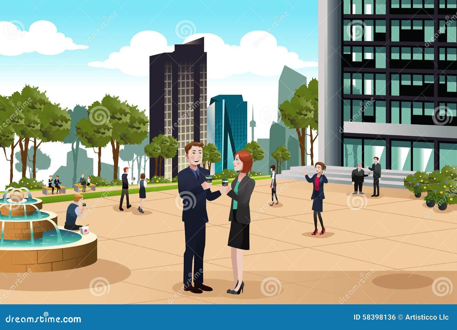 Ludzie Biznesu Opowiada Na zewnątrz Ich budynku biurowego