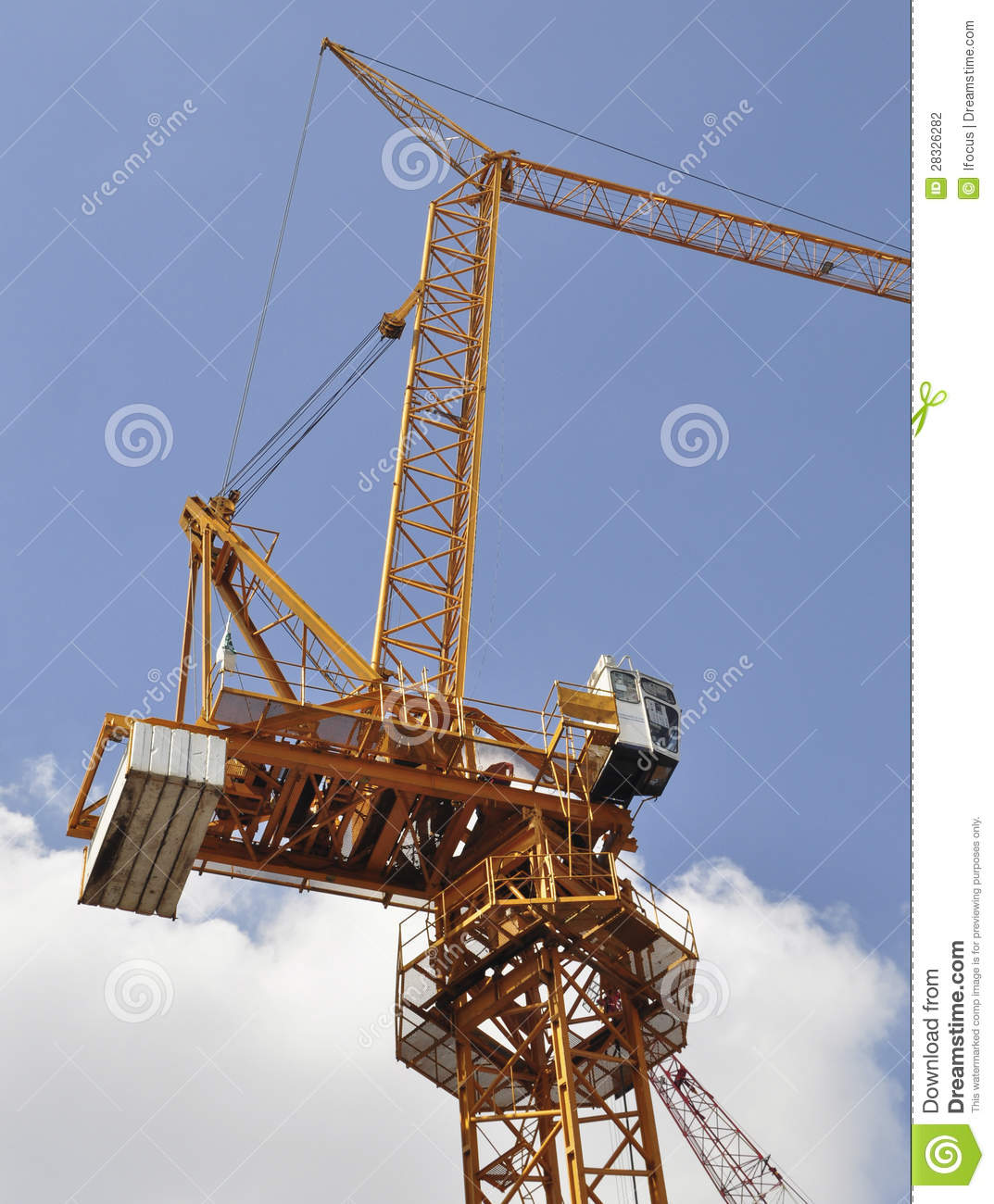 Jib Crane Usage : Luffing jib tower crane against blue sky stock photography