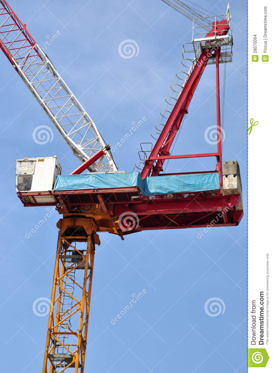 Jib Crane Usage : Luffing jib tower crane against blue sky stock images