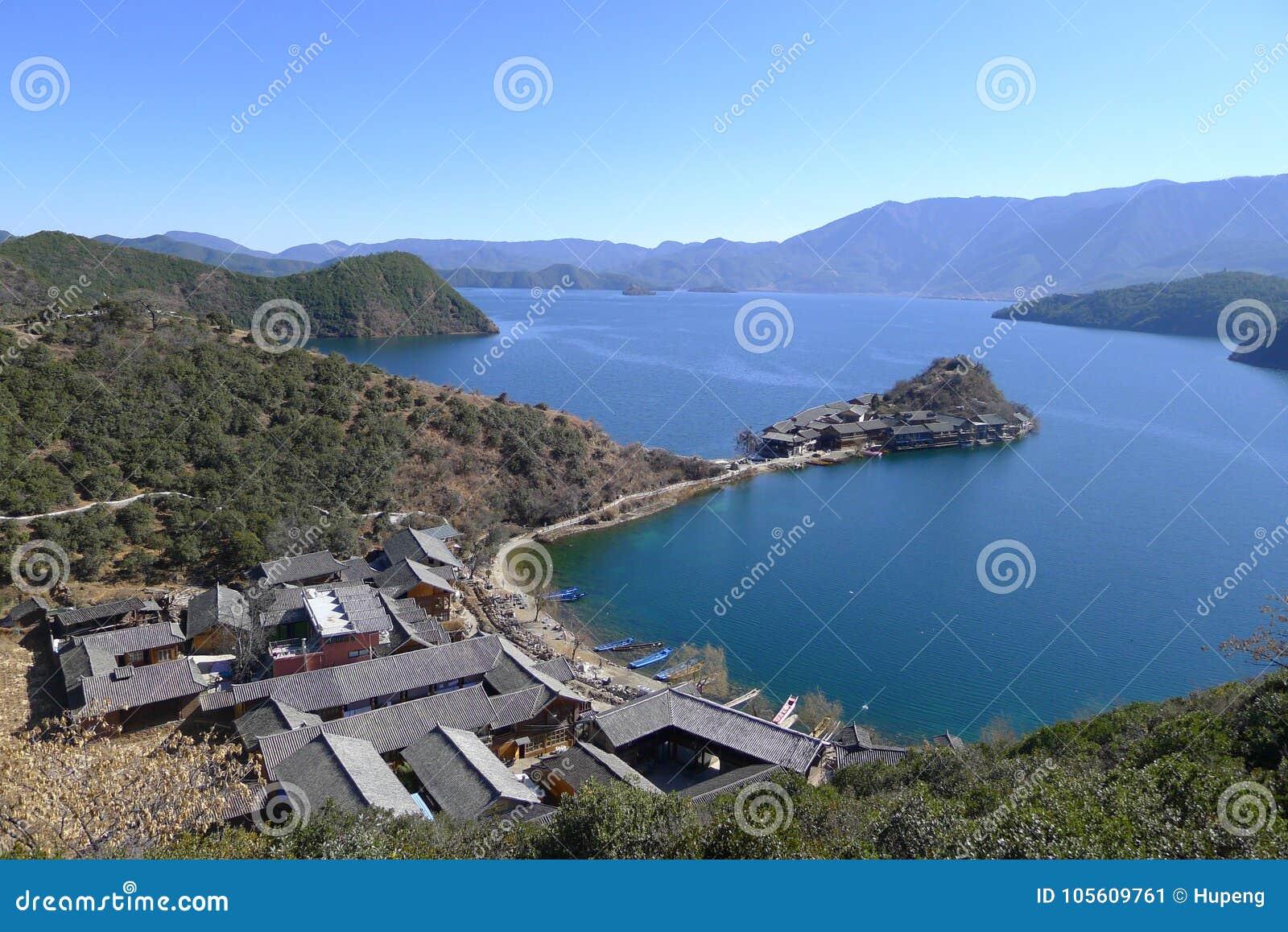 Lugu lake Li ge island stock image  Image of boat, house - 105609761