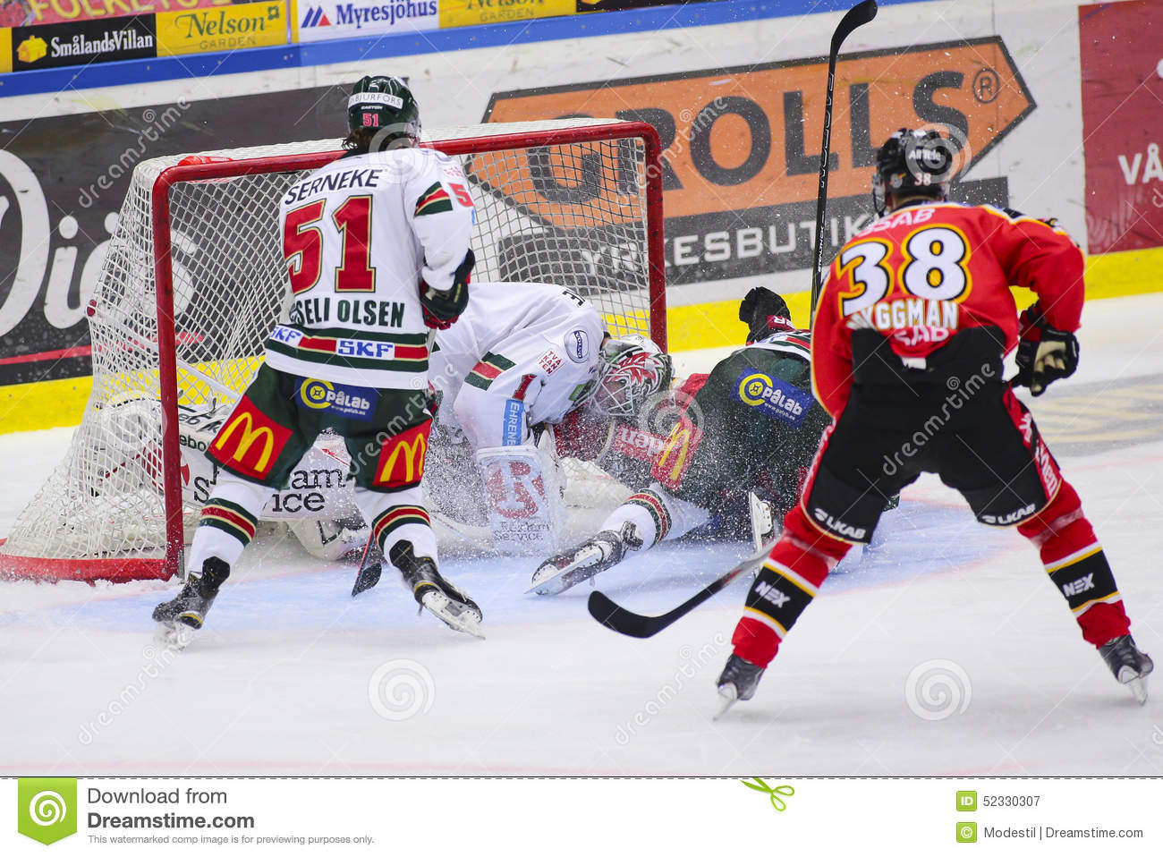 Lulea, Sweden - March 18, 2015. Karl Fabricius (#52 Lulea Hockey) slides with full speed into opponents goalie. Swedish Hockey Le