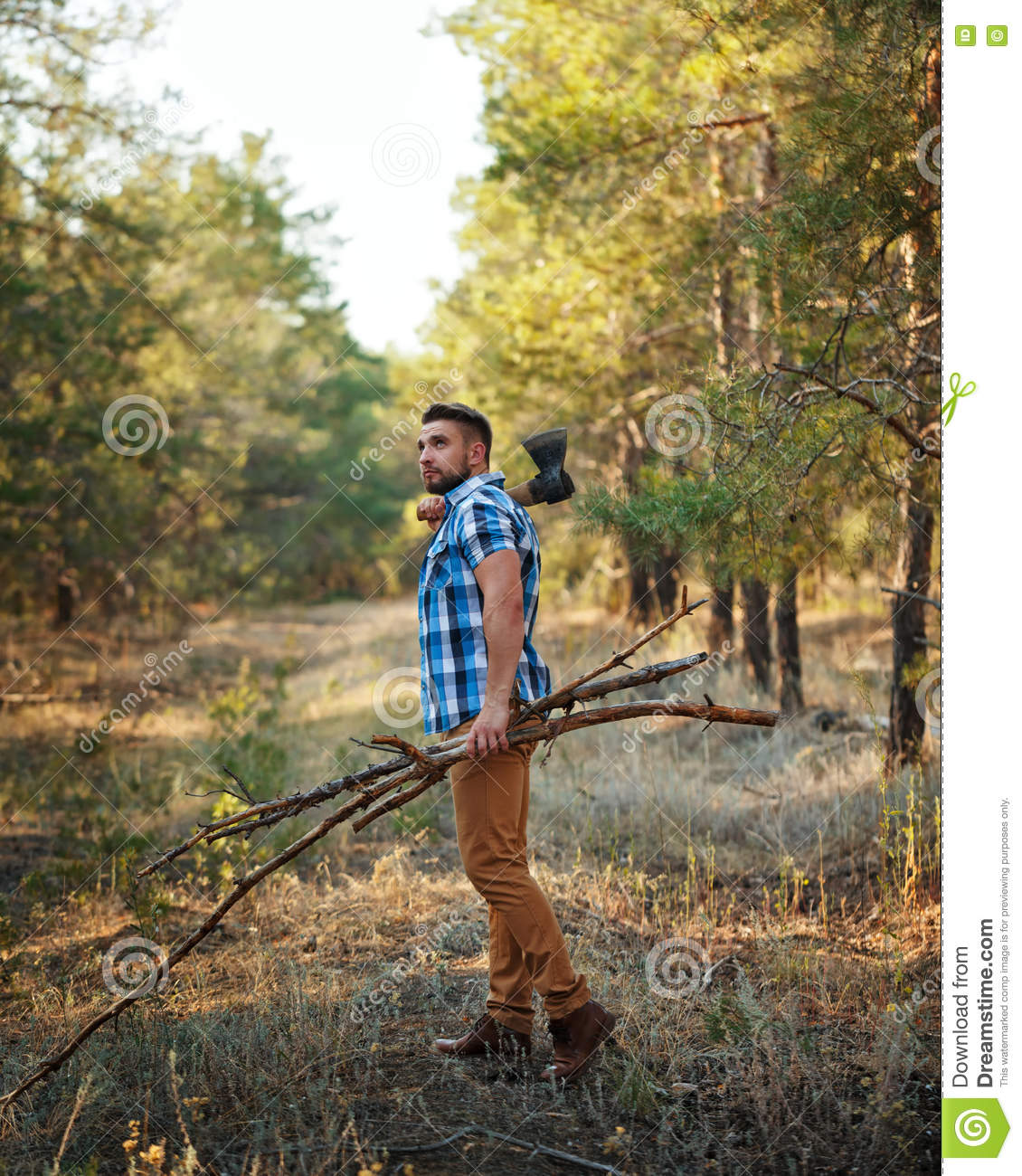 Lumberjack With Ax Goes Through The Woods. Woodcutter With