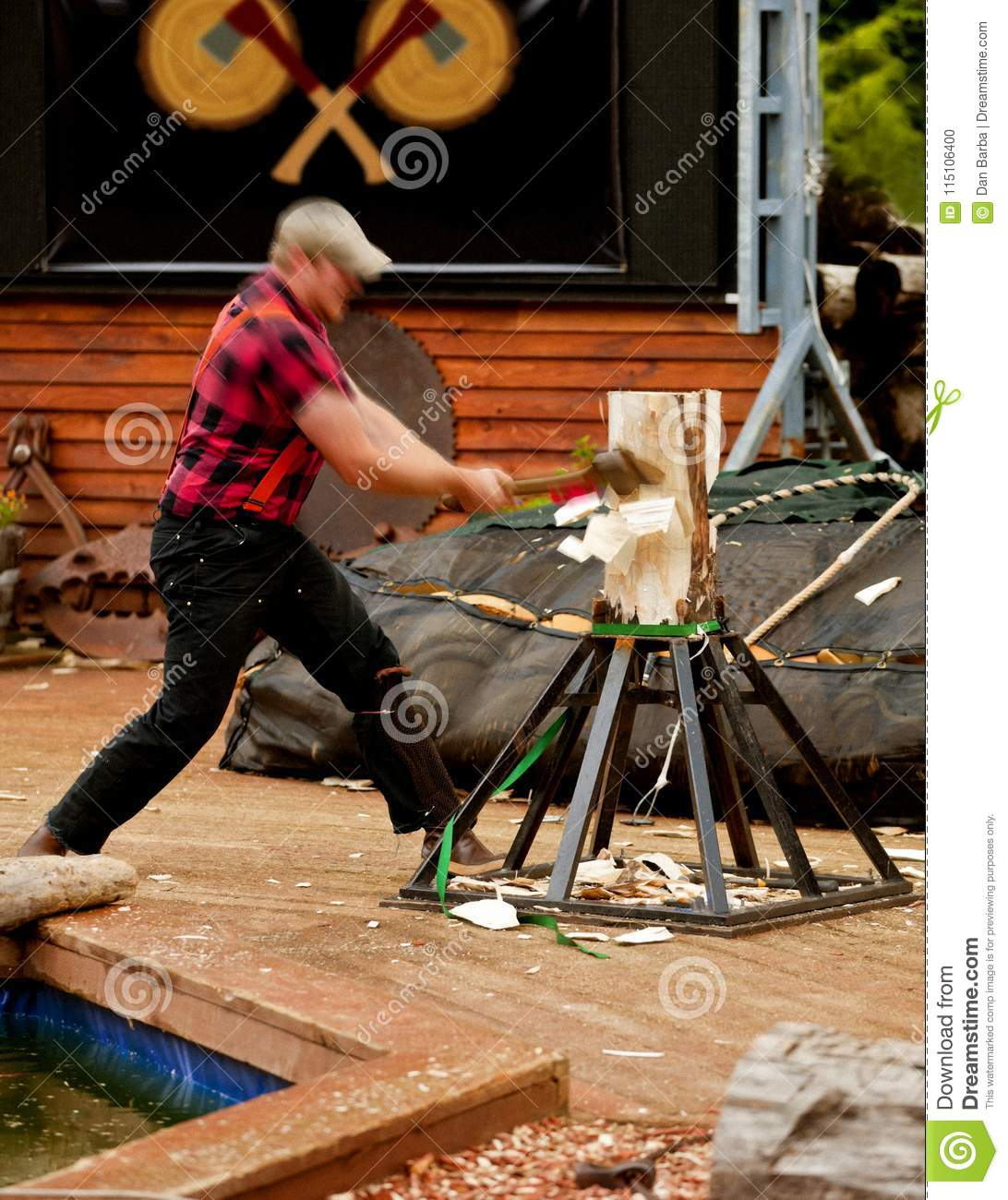 LUMBERJACK HACKING INTO LOG WITH AX AND CHIPS FLYING ALL OVER