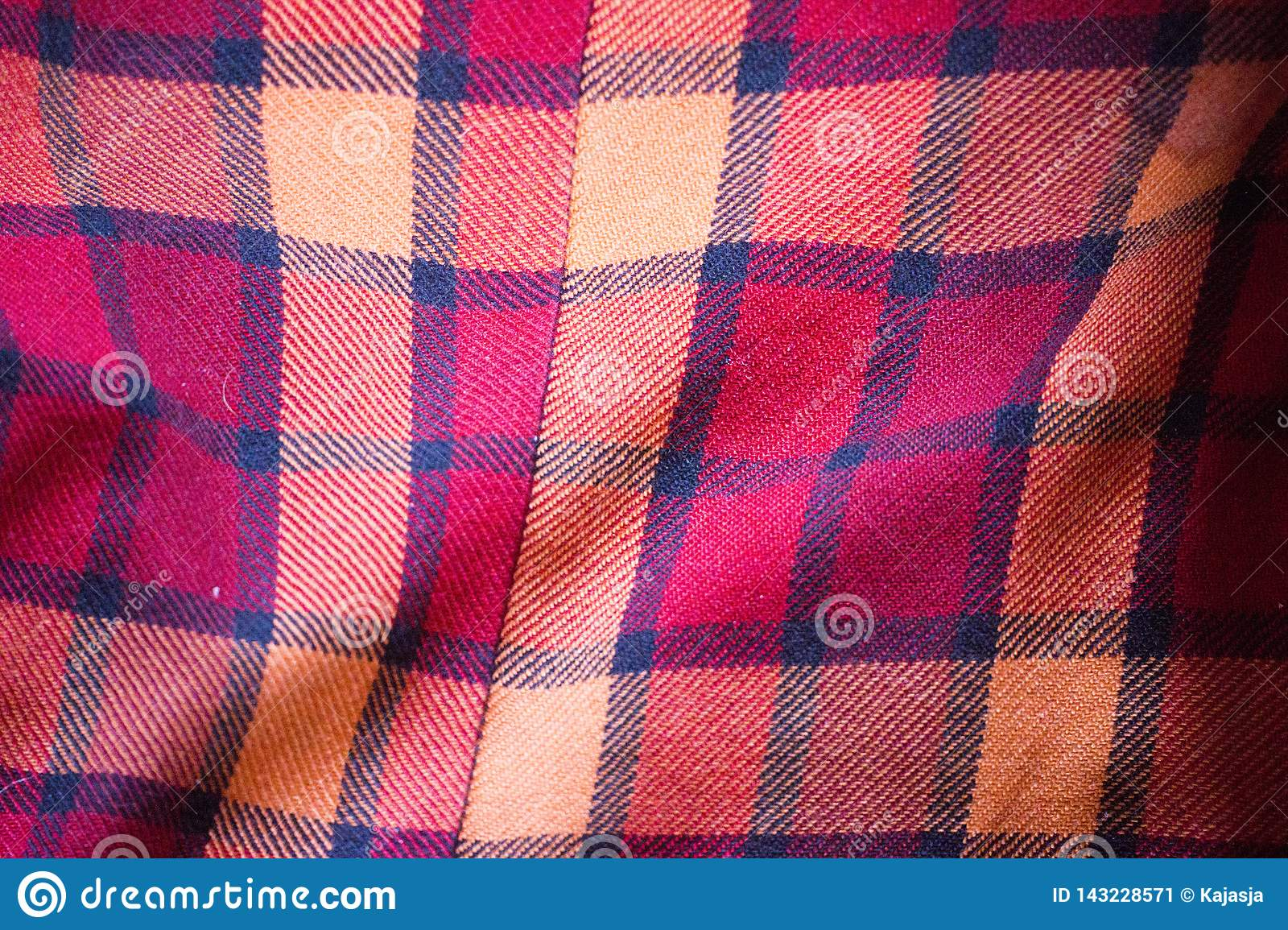 The texture of the red wool plaid fabric