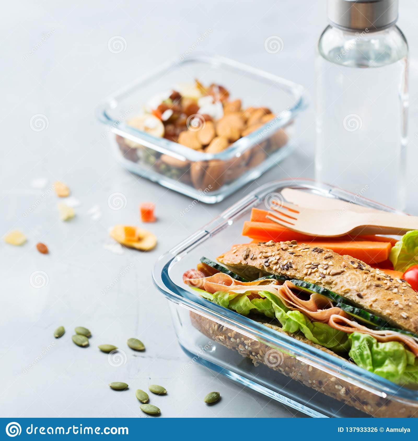 Lunch Box With Sandwich Fruits Vegetables Nut Mix And Water Stock Photo Image Of Business Diet 137933326 Is that sandwich is sandwich while water is (uncountable) a chemical, found at room temperature and pressure as a clear liquid, having as a verb water is. dreamstime com