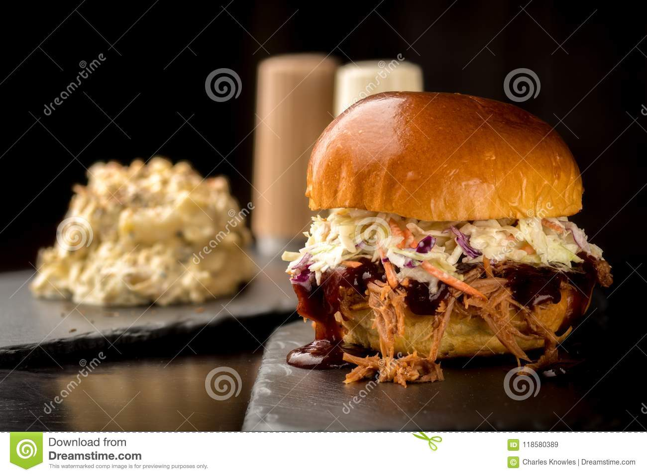 pulled pork sandwich with a heaping helping of potato salad stock