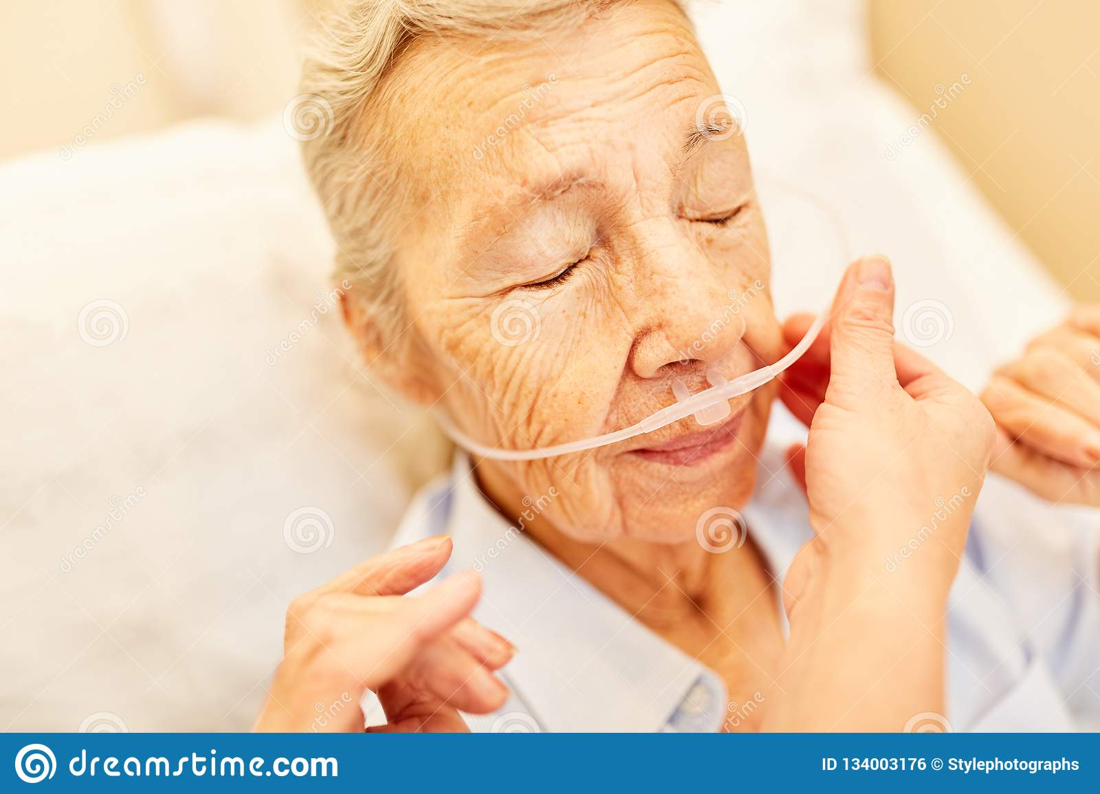 Senior with oxygen glasses in respiratory therapy