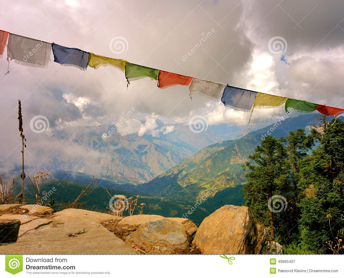 Lungta Buddhist flags and Mountains Valley with Clouds