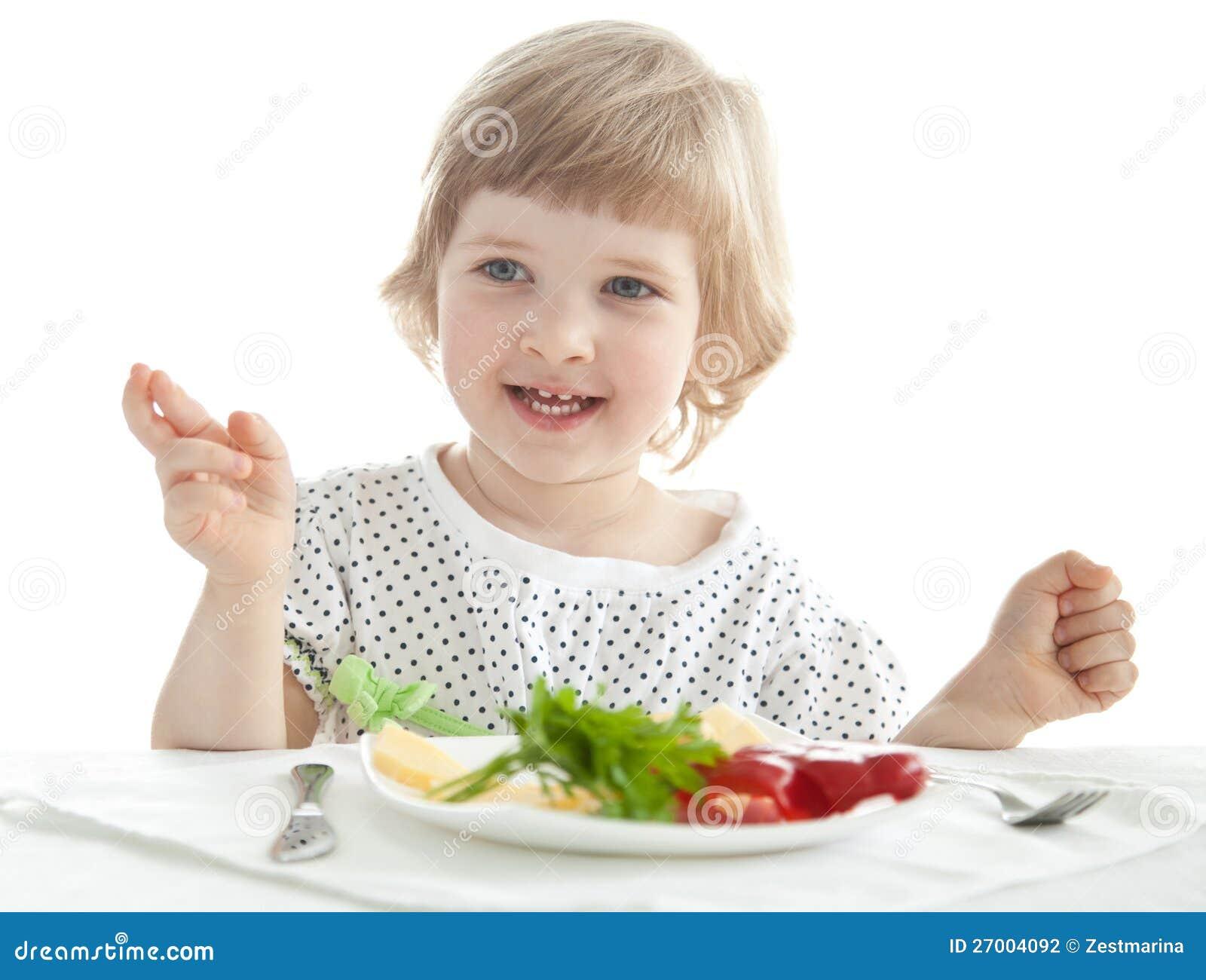 Lustiges Essen des kleinen Mädchens