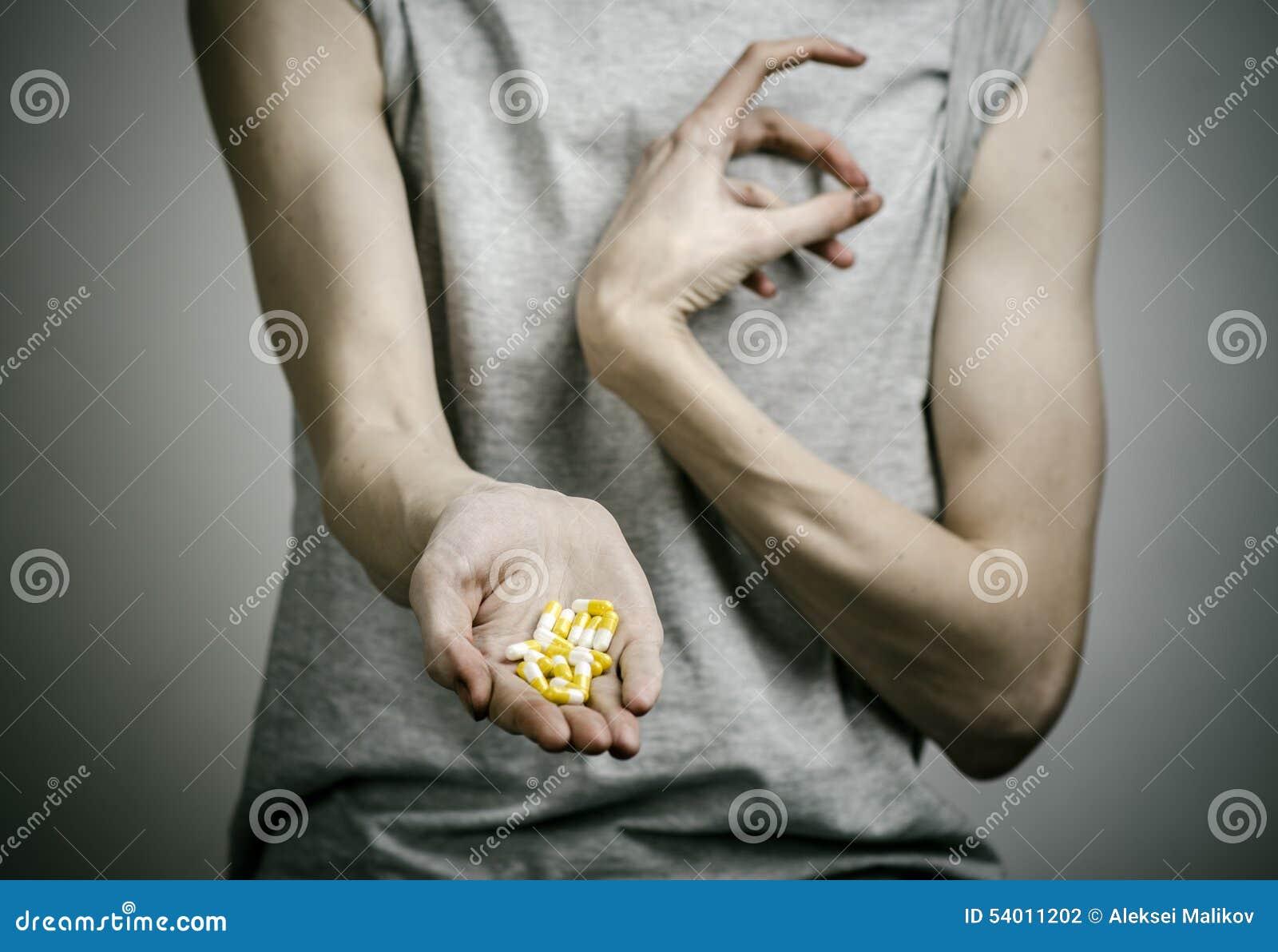 A luta contra drogas e assunto da toxicodependência: dedique-se guardar comprimidos narcóticos em um fundo escuro