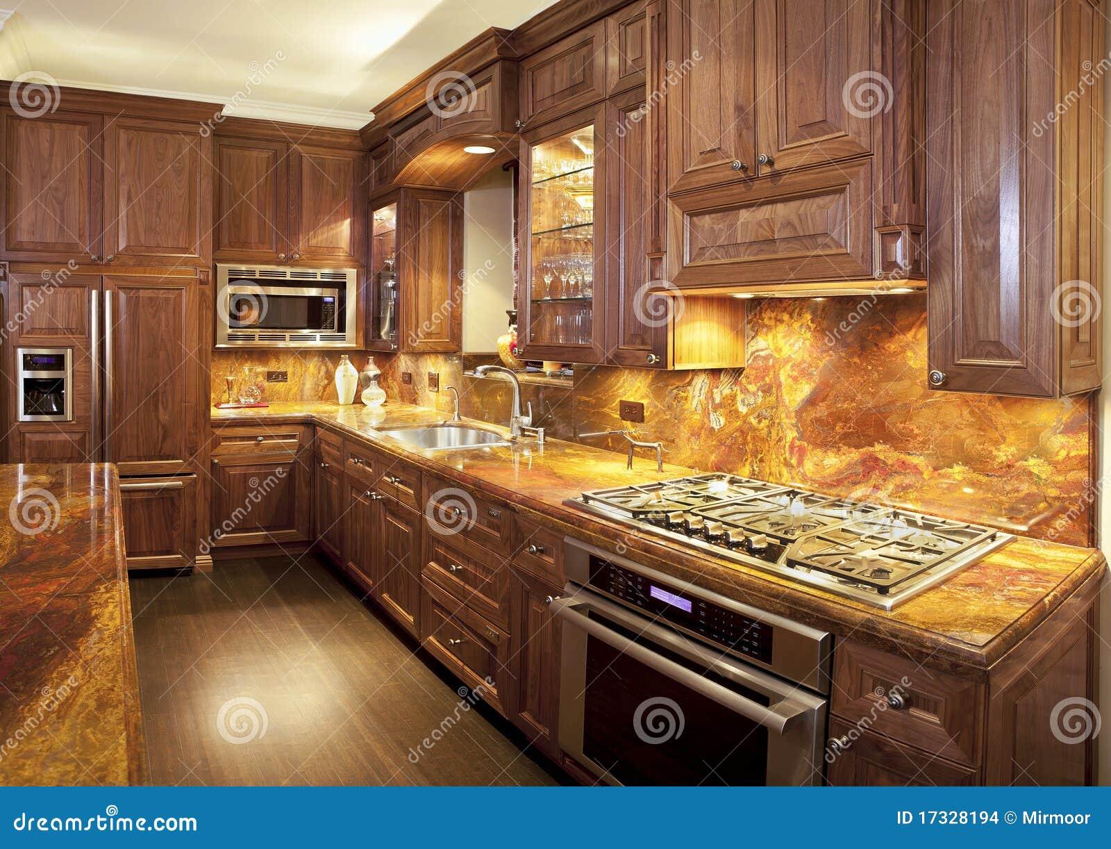 Luxo cozinha contemporânea com partes superiores contrárias do  #B98912 1300 1010