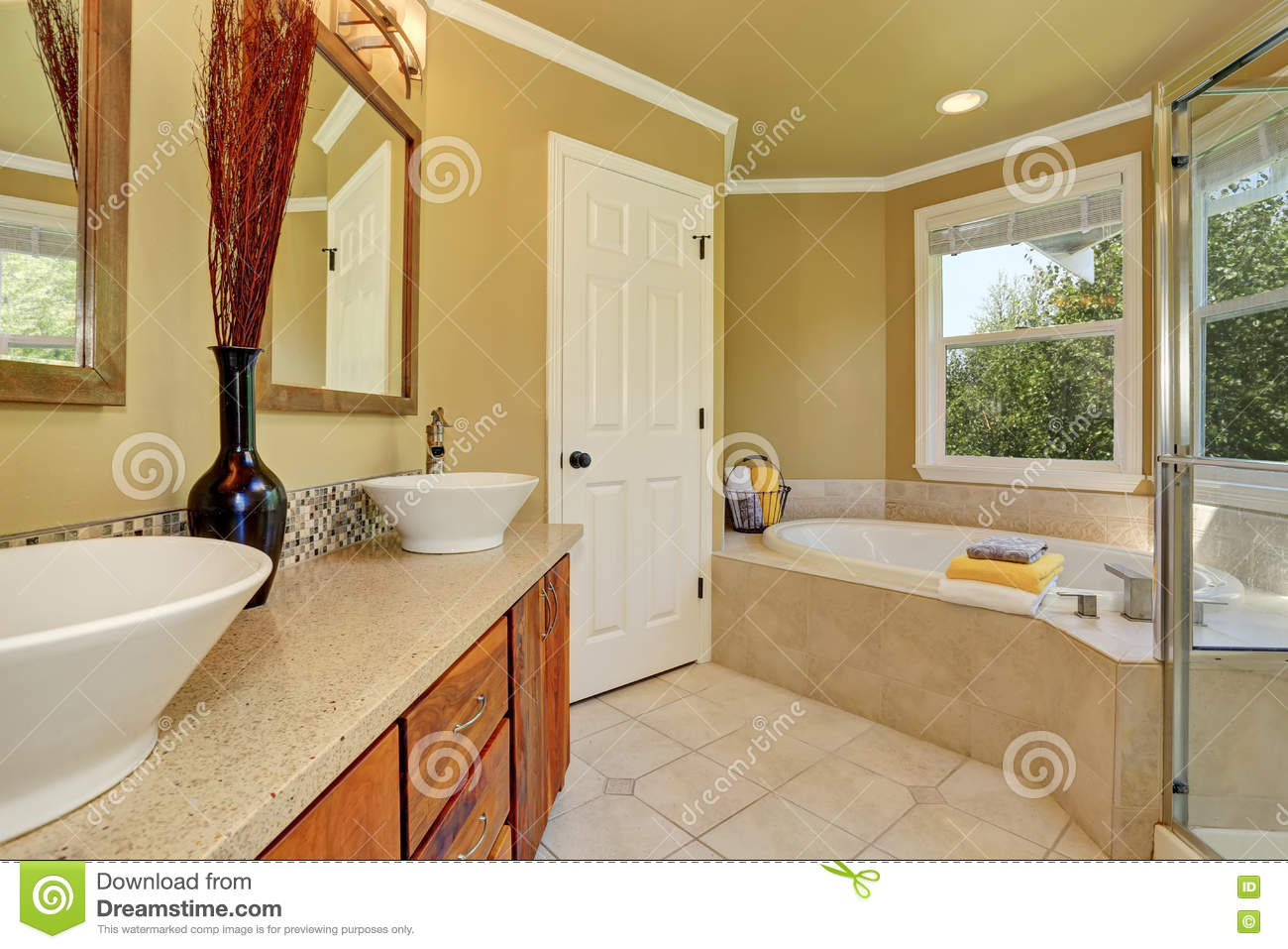 Bathroom in warm colors with a toilet a bathtub a for Warm bathroom colors