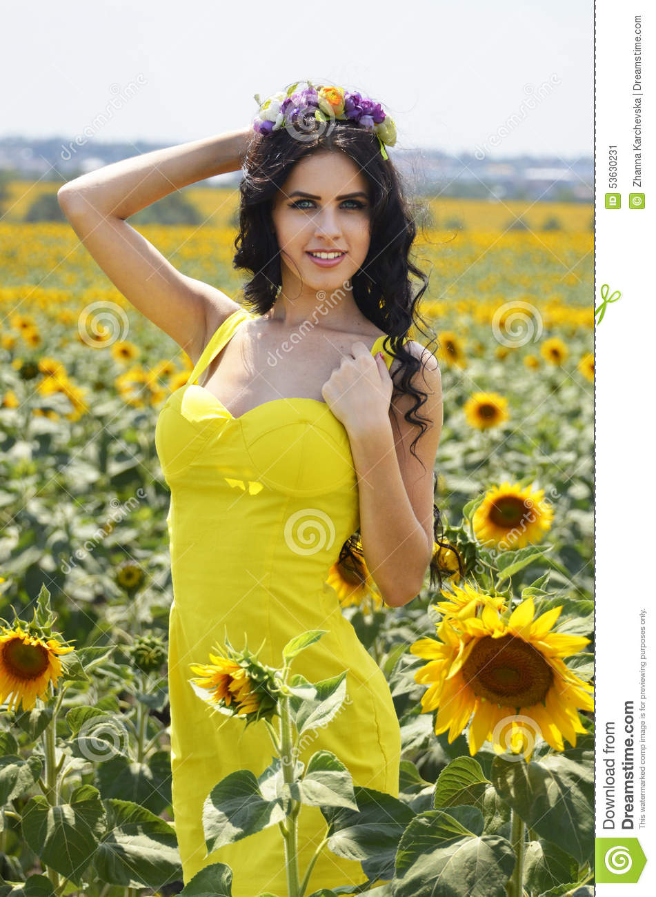 Luxurious brunette in a yellow dress with flowers stock image download luxurious brunette in a yellow dress with flowers stock image image of yellow mightylinksfo