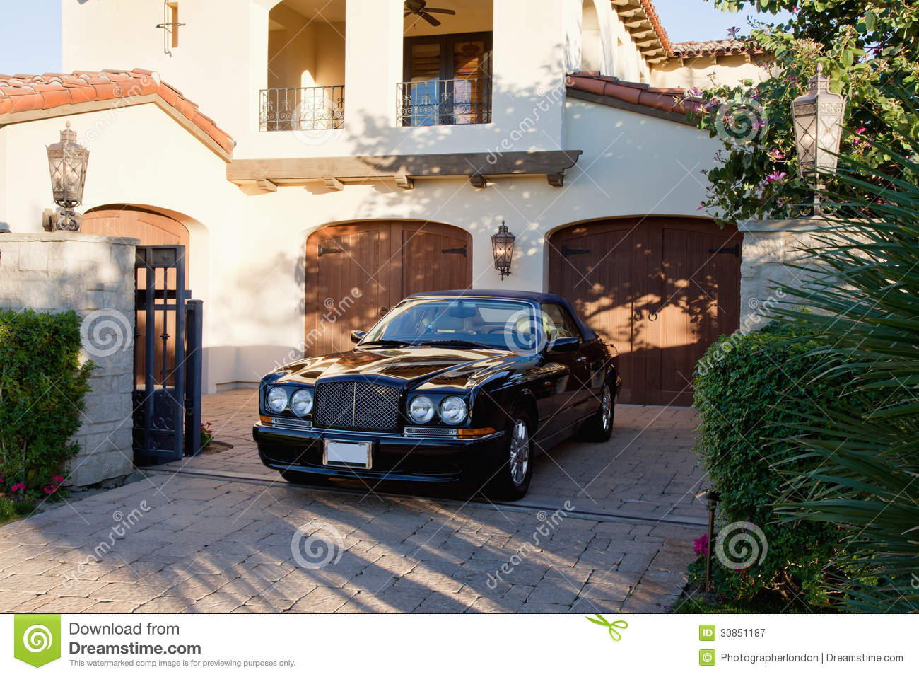 Luxurious Car Parked In Entrance Gate Of House Royalty