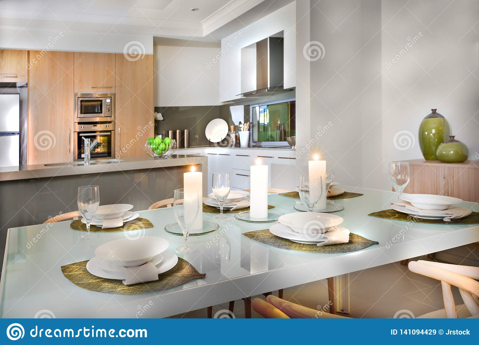 Luxurious Dining Room Table Set Up Near To The Kitchen Stock Image ...